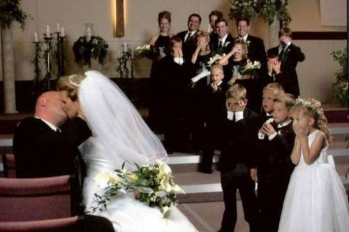 10 Awkward Wedding Kiss Photos Captured