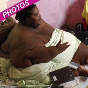 LANOISE, WHO WEIGHS 500 POUNDS, SPEAKS WITH A VISITOR AT HER PROVISIONAL HOME IN BOCA CHICA