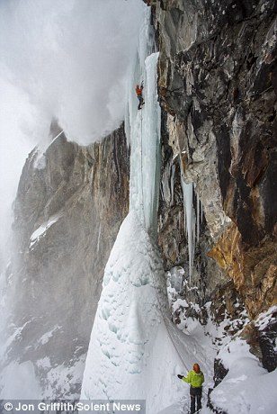 Photographer captures heart-stopping moment avalanche engulfed climber clinging to frozen Alps waterfall