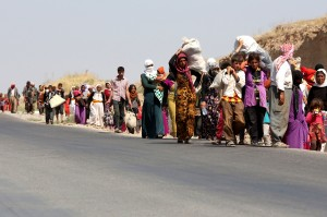 Displaced Yazidi's cross the Iraqi-Syrian border at the Fishkhabur crossing in northern Iraq. Photo: Getty Images