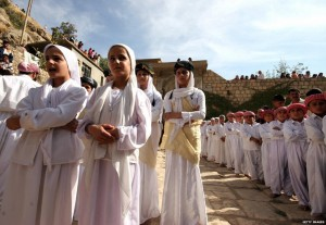 Girls and boys from a Yazidi religious school sing hymns and prayers at Lalesh temple