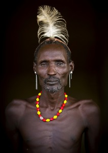 Dassanechmen wear the typical hair if they have recently killed an enemy or a dangerous animal, bear head of ostrich feathers