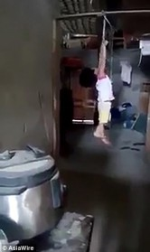 CHILD ABUSE: Five-year-old girl screams after being strung up by her wrists by her cruel Vietnamese foster mother to punish her for taking a carton of milk