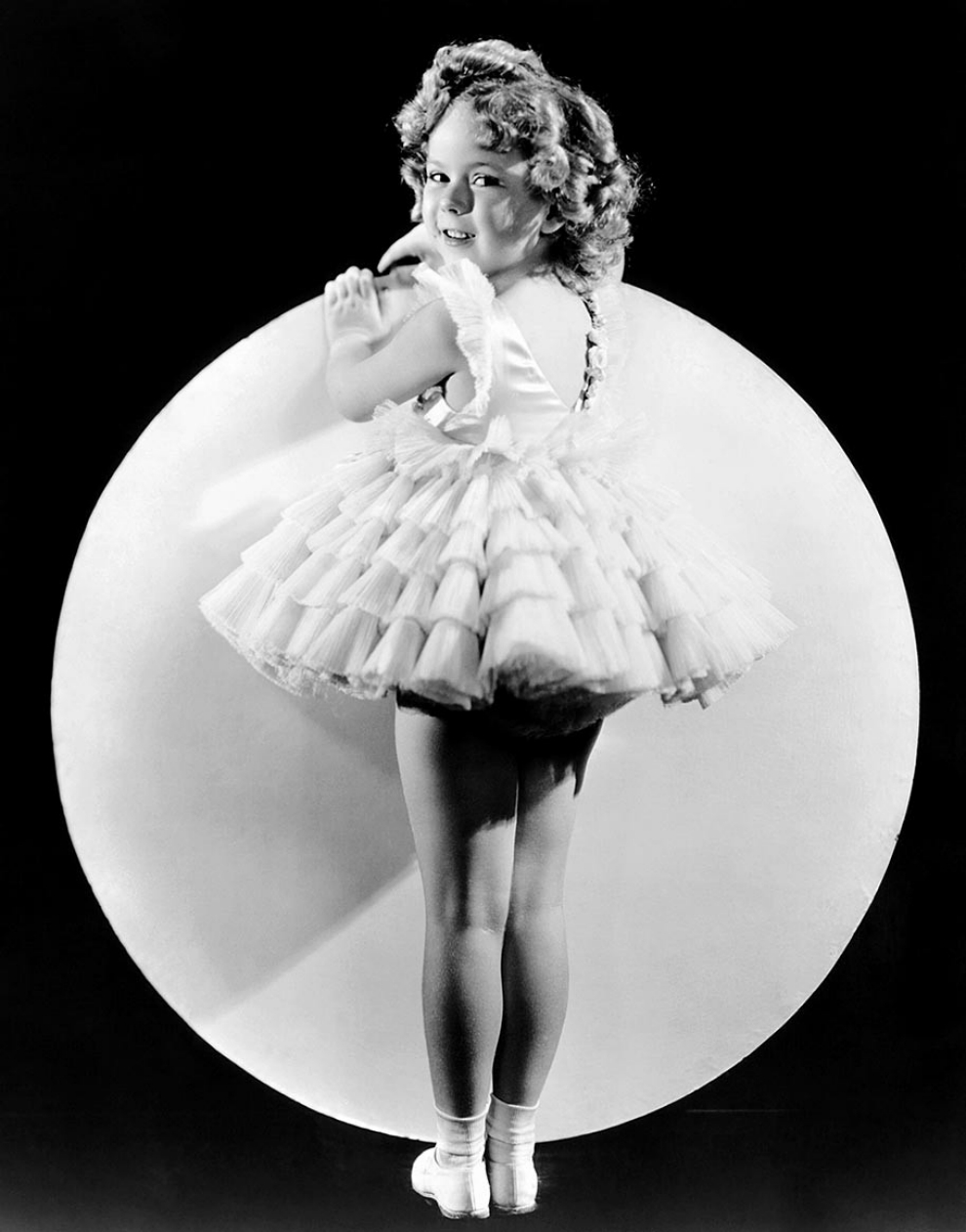 ENTERTAINMENT: Shirley Temple (Black) Would Always Be America's Darling Of The Depression Years And An All-time Child Star Icon